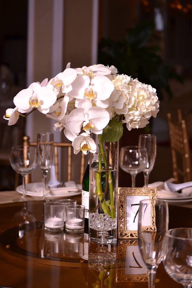 Orchid and hydrangeas centerpiece chez rose floral