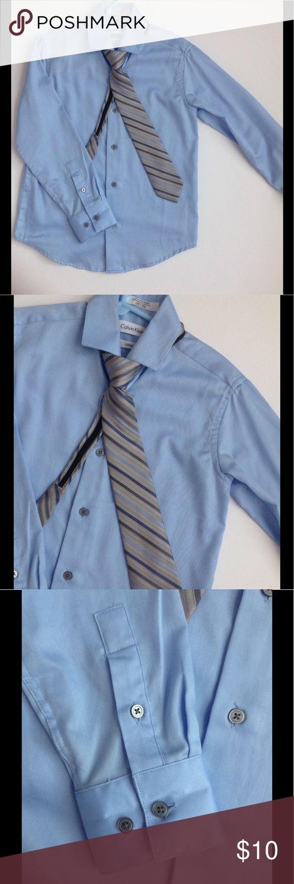 Calvin Klein Boy's Long Sleeve Sateen Dress Shirt WORN ONCE. Long sleeve dress shirt with button front placket and shirttail hem. Spread collar. Buttoned cuffs. Dry clean only. Zipper tie included. Calvin Klein Shirts & Tops Button Down Shirts