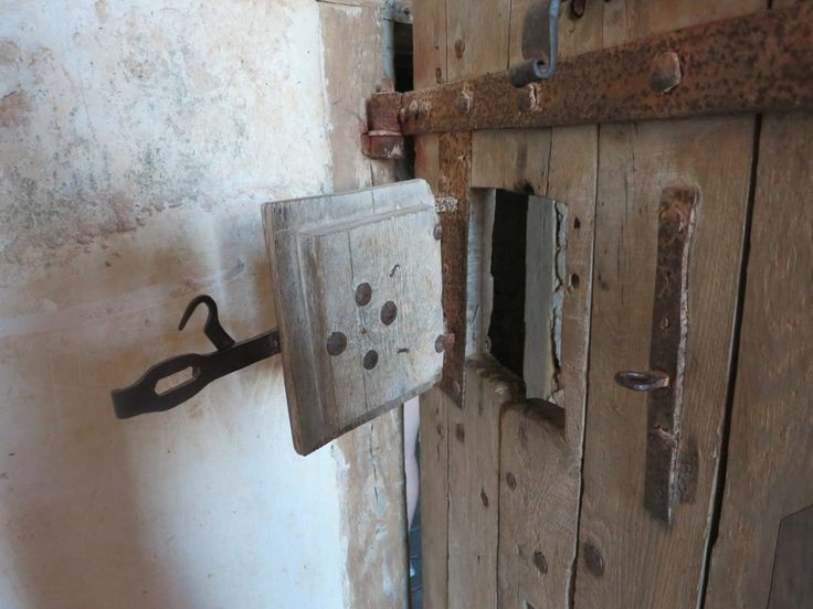 the peephole of a prison cell in the basement of Chateaudun