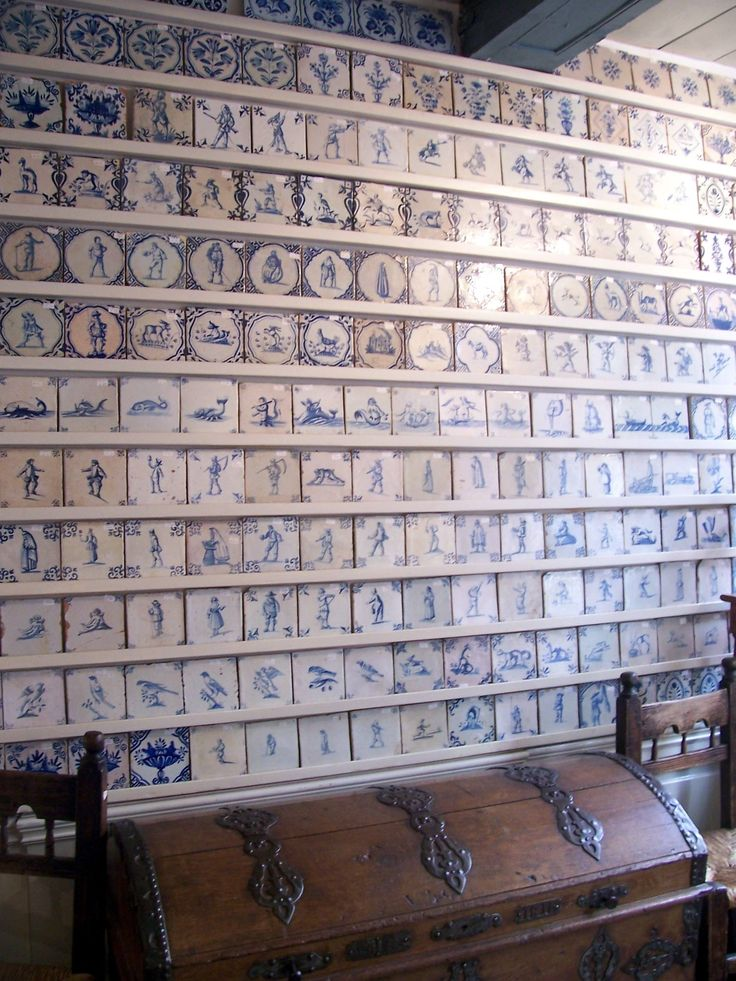Delftware is synonymous with Delft and is the brilliant blue ceramic pottery that has made this city famous.  In this shop, the walls were lined with antique Delft tiles sporting depictions of things like whales, flowers, people and birds.