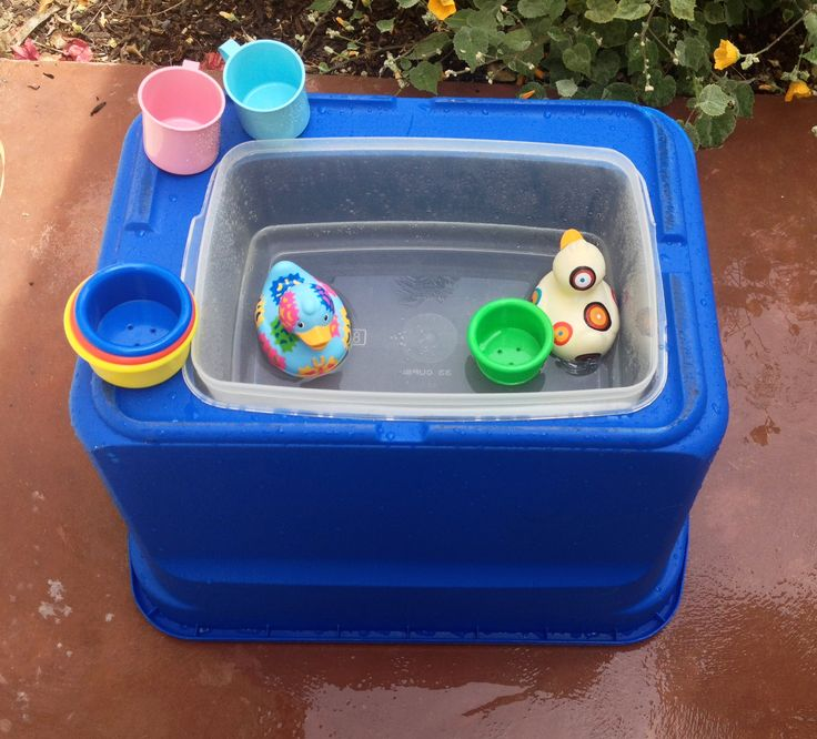 DIY water table!  large plastic storage tub turned over... cut hole for smaller plastic tub (with lip so it stays up)... water and toys! perfect height for a 1 year old.