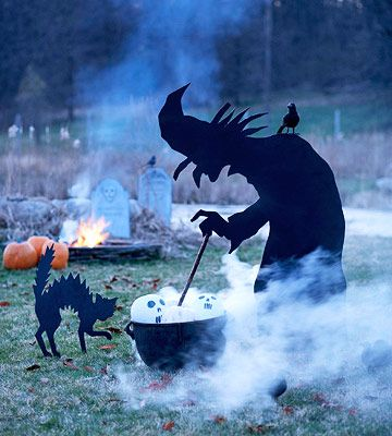 Stop traffic with a spine-chilling spectacle. Outfit a plywood witch with a coat of black paint. Stick the hardworking hag in the ground near a cauldron filled with white pumpkins painted with scary faces. The bubbling, fog-producing dry ice adds just the right touch to this Halloween scene.