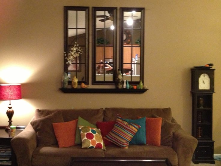 $50 for 3 full length bronze kirklands framed mirrors with coupon, $6 for trim at lowes, cut to size  and painted espresso and glued with liquid nails to the mirrors! For $56 I have my favorite homemade window pane mirrors in the house:)