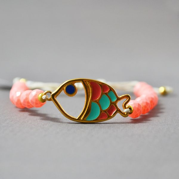 "Handmade Summer bracelet ""Small Fish""made with a gold plated element and small glass beads.  It can be worn alone or with other similar bracelets.  The bracelet is adjustable so It can fit various sizes."