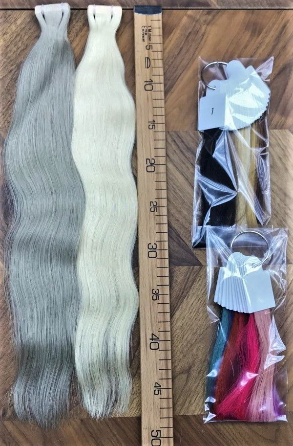 Tape in hair. The tape base has a hair color for d…