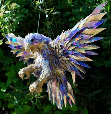 Scare away the birds from your garden by making a raptor like this from shattered CDs. These animals are works of art.