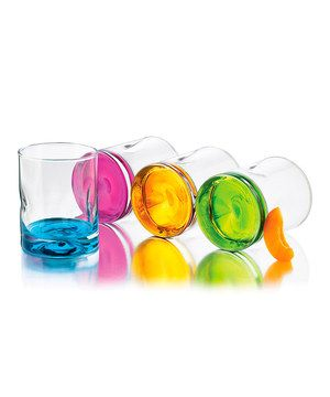Colorful and classic—these rocks glasses provide a stylish way to serve cocktails, juice and more. The weighted, tropical-hued bases provide everyday delight and help prevent spills!