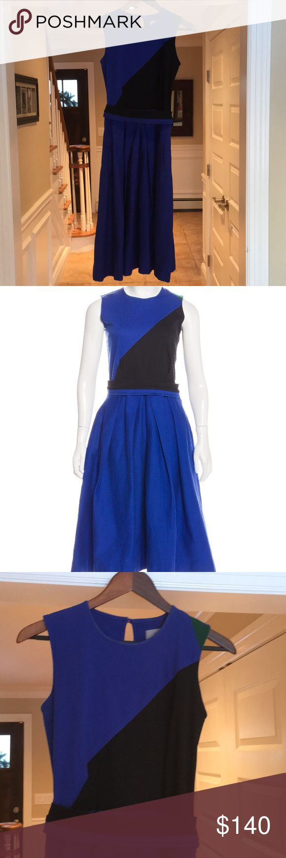"""Preen Line Blue Black Green Cotton Drill Dress M Beautiful dress from Preen Line, which is a favorite of Kate Middleton's.  This cobalt blue, black & emerald green A-Line dress is sleeveless, features an exposed side zipper, 2 front slit pockets, button closure at keyhole back, pleated front & back on skirt & a black & blue pleated belt.  It's a size medium & is a thick stretch cotton material.  Approx meas are: 42 1/2"""" length, 16"""" across under arms, 13"""" waist.  In excellent pre-loved…"""