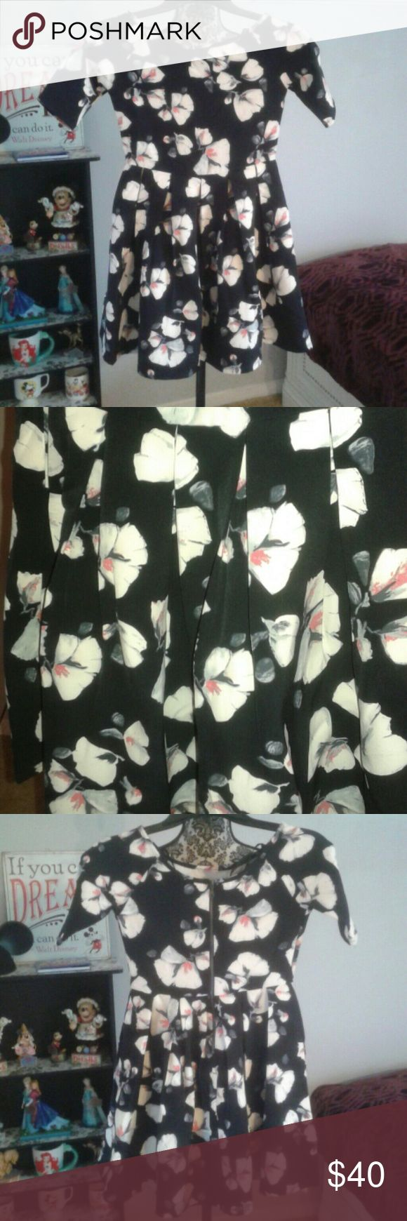 Floral 'Miss Beahve Girls' dress Super cute black floral 'Miss Beahave Girls' dress with pleated bottom. It's about 27 1/2 inches long. It's brand new with tags! Never worn and in excellent condition! I will answer any questions! :) Miss Behave Girls Dresses Mini