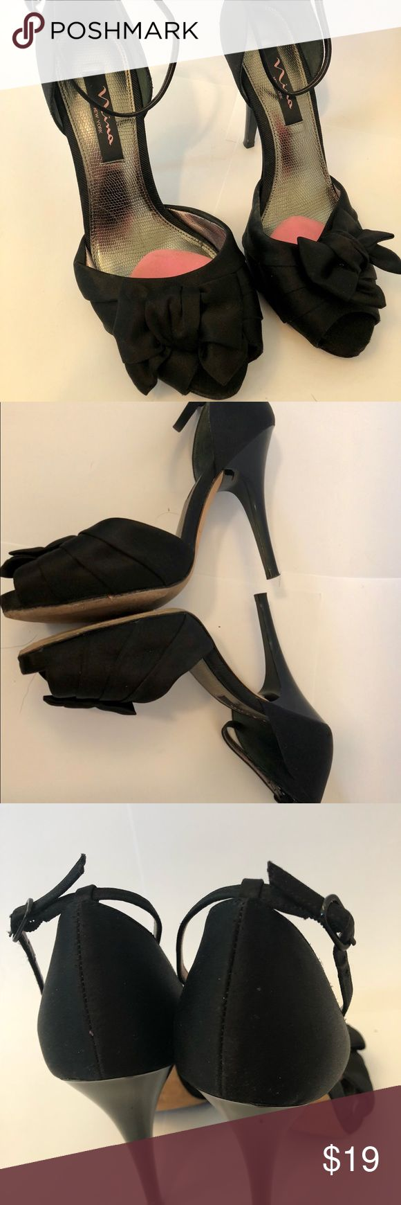 Nina peep toe heels with bow accent Satiny black heels with bow accent on the toe. Great shoes for going out. Added a toe box pad for increased comfort while dancing. In worn condition with slight scuffs on the front of the shoe(visible in picture). Not noticeable while wearing. Nina Shoes Heels