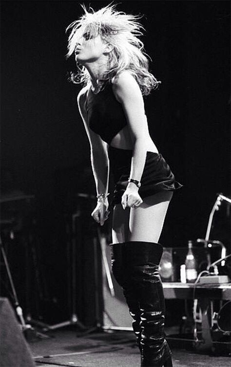 Debbie Harry Blondie....the lady of the band. Look to follow- Electric blonde hair, little dress number, sexy boots.