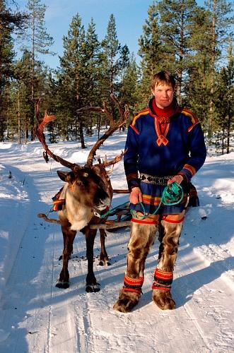 (Frozen....anyone????). Sami in traditional dress with reindeer, Jukkasjärvi Sweden