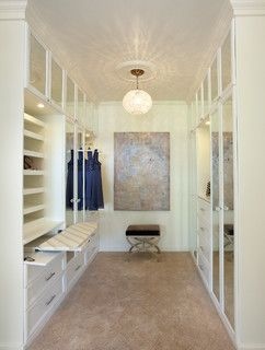 Like the Ironing board in the walk in robe - smart use of space
