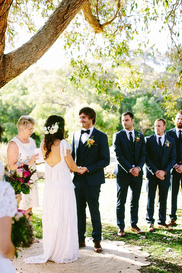 Bright Bohemian Winery Wedding up on the wedding playbook.com featuring Rue De Seine Eve Gown. xx Location: Western Australia   Photography: Bianca Kate Photography   Venue: Arimia   Celebrant: Kathy Lynn Pilkington   Flowers: Dunsborough Florist   Cake: Bake the Cake   Cake Topper: Etsy   Furniture Hire: The Zest Group WA   Lighting & Dance Floor: Cape Marquees   Bride: Rue De Seine from Through The White Door & Grace Loves Lace (Shoes & Anklets)   Bridesmaids: Hippolyta Lace Skater Dress…