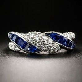 Here's a vintage high-quality jewel with a delightful twist. Substantially and comfortably crafted in gleaming platinum during the middle of the last century by the notable American jeweler - Oscar Heyman, this beautiful band ring alternates with sparkling pave-set diamonds and royal blue calibre sapphires. Not signed (per usual) but numbered inside ring shank 00109, .90 carat total diamond weight, currently ring size 8 1/4.