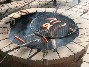 Swivel clip on grill kit for a metal fire pit
