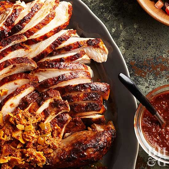 A super spicy mole sauce and a stuffing of fiery chorizo, tomatoes, and Anaheim chile pepper make this turkey recipe one that will change the way you think about poultry.