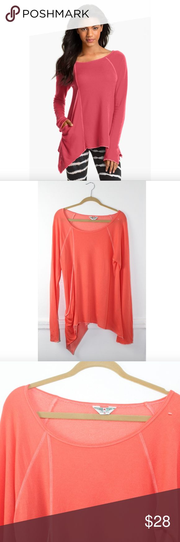 """Hard Tail 'Frolic' Coral Asymmetric Top Hard Tail 'Frolic' Coral Asymmetric Top, Size Medium, Coral/orange color, Long sleeve, An angled inset panel creates unexpected draping down one side of a buttery-soft knit top designed with a single slouchy pocket. Thin lightweight sweatshirt type material, Exposed seaming, Approx. length from shoulder: 24 1/2"""" to shortest point; 30 1/2"""" to longest point, 76% Tencel lyocell, 24% cotton, Machine or hand wash cold, tumble dry low, Pre owned great…"""