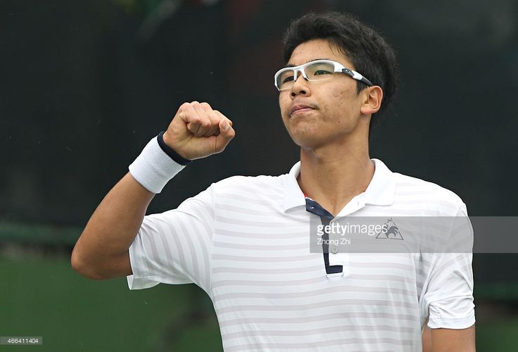 Hyeon Chung of Korea reacts during his match against Roberto Carballes Baena of Spain during the ATP Challenger Guangzhou Tour Day 5 at Guangzhou Development District International Tennis School on March 14, 2015 in Guangzhou, China.