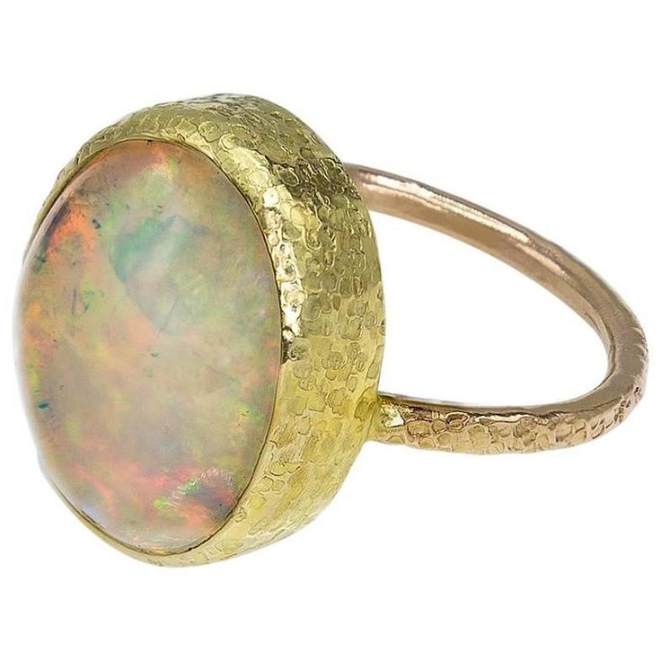 Opal Set in Textured Gold Ring   From a unique collection of vintage solitaire rings at https://www.1stdibs.com/jewelry/rings/solitaire-rings/