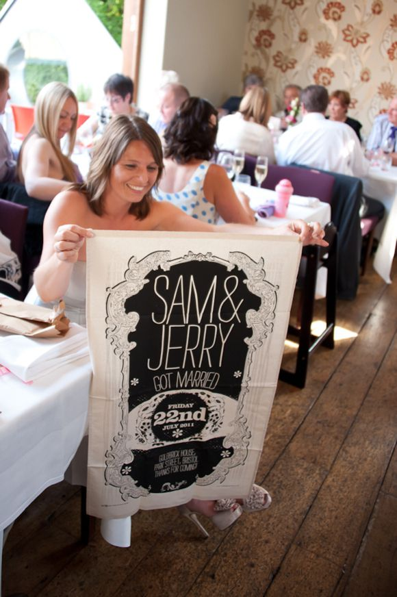 Tea towel favors -- this would also be great as a sign for reception decor or a photobooth prop.