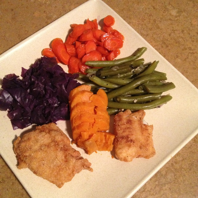 Pan fried Haddock, Carrots cooked in orange juice & ginger, steamed purple cabba...