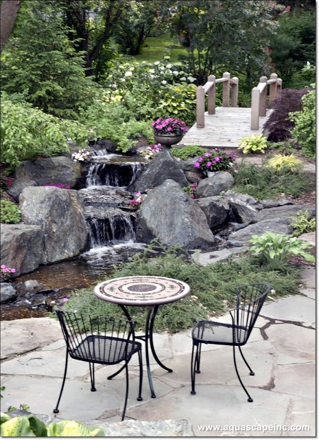 Patio Near A Pond And Waterfall   Note The Bridge Inviting You To Explore  More Of