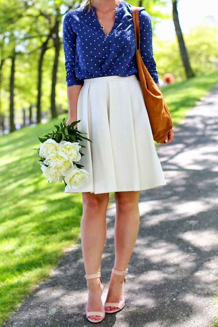 Blue polka dotted button-up, white pleated skirt, minimal blush sandals, brown bag