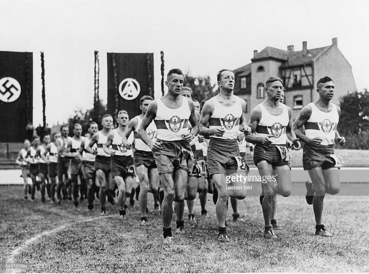 Germany, Third Reich - NSDAP Nuremberg Rally 1937 Participants of the Police Force entering the stadium for the NS combat games