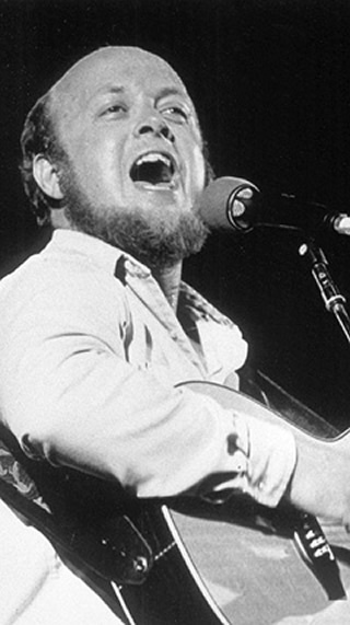 "Stan Rogers was a Canadian folk singer, known for songs such as ""Northwest Passage"". He was flying home on AC797 after a Folk Festival and died, (at the age of 33), helping others to safety at the front exit of the fiery aircraft while calling out, ""Follow My Voice!"" in his deep baritone.  The movie might open on the flight and a series of flashbacks would illustrate Stan's life and loves as we cut back to his final heroic moments. (Casting hint: Nathan Rogers, his folk-singer son, is 33.)"