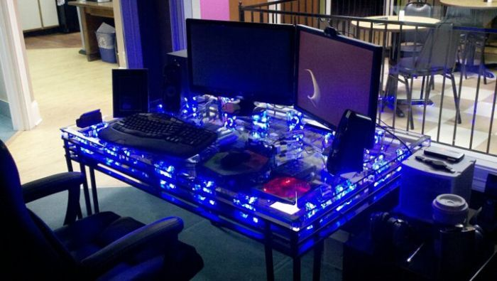 Computer built into a glass-top, and glass-bottom table.