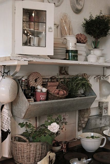 I like this unconventional look for the kitchen. So much more interesting and fun that regular storage.