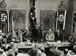 Founding of the Nazi Party in Munich, 1925. From left: Rosenberg, Buch, Schwarz, Hitler, Gregor Strasser, Himmler. Lower right: Julius Streicher