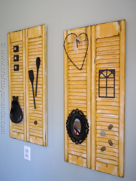 Turn old shutters into fabulous wall art with some paint and sand paper