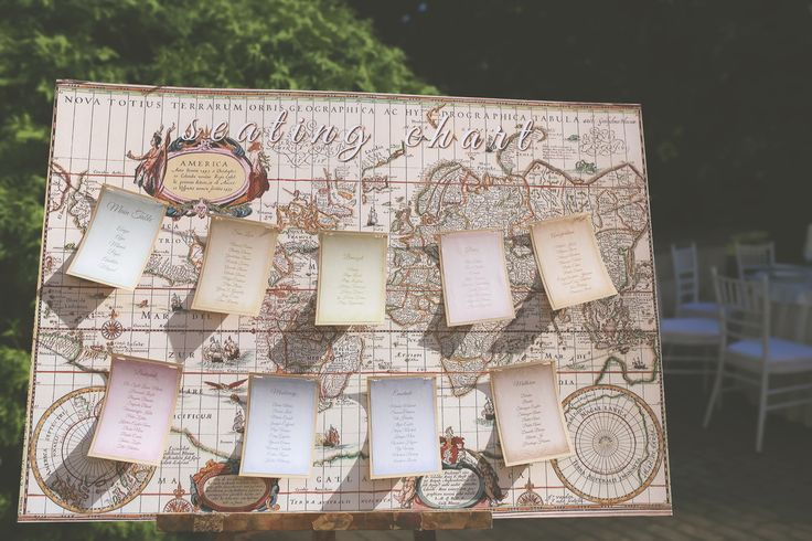 "World map seating chart with pastel colors and ""clip-on"" tables for international weddings"