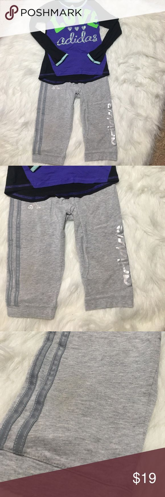 """Adidas Girls Bundle Capri & Shirt 6/6X Athletic Adidas Girls Bundle Capri & Shirt 6/6X Athletic bottoms are size 6X and measures approx 10 1/2"""" waist laying flat, 7"""" rise, 10 1/2"""" inseam pants have slight stain at bottom as shown. They have silver adidas on side of pants, super comfy material. Shirt is Black with Love in Green Adidas is in Glitter print. Measures approx 10"""" underarm to underarm, 17"""" long. Good used condition shirt is size 6 adidas Matching Sets"""