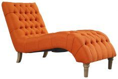 Block & Chisel orange upholstered button tufted lounger with wooden legs