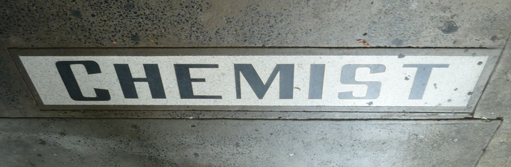 Art Deco Chemist sign in the footpath in front of chemist shop - Murwillumbah, NSW