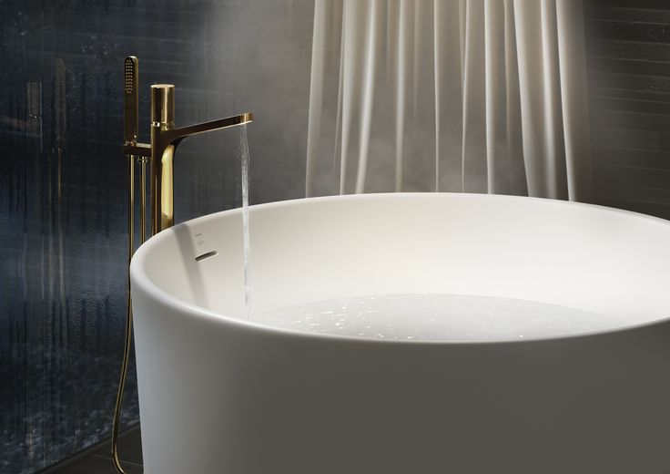 Round #freestanding #bathtub   with floor mounted tap. #Equilibrium collection. Designed by #edwardvanvlietofficial by #pomdorbathworld and #official_rosenthal.