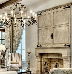 Loving fireplace and chandelier with a shabby look
