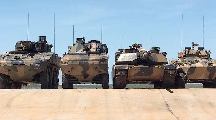 Left to right – Rheinmetall Boxer CRV, BAE Systems Australia/Patria AMV-35, an Australian Army Abrams main battle tank and an ASLAV at Mount Bundey, Northern Territory. Photographer unknown.