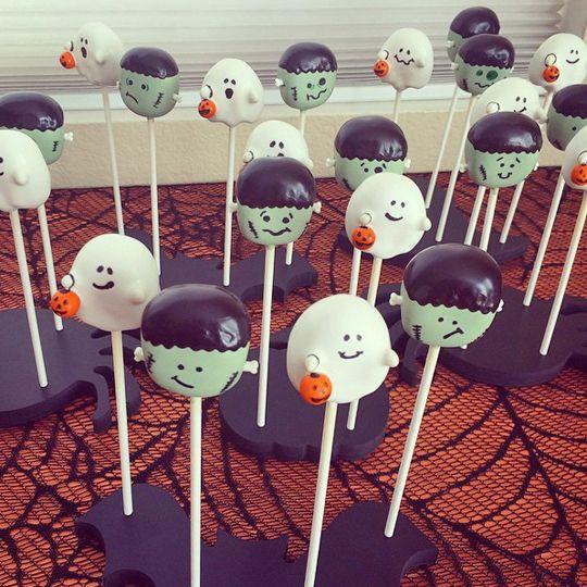 Halloween cuteness overload! Adorable Frankenstein and ghost cake pops displayed in Halloween cake pop stands: