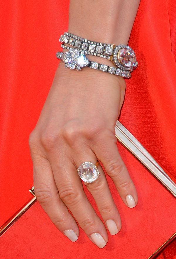 Oscar presenter Jennifer Aniston wore vintage diamond jewelry by Fred Leighton (and her engagement ring from Justin Theroux) perfectly paired with her red Valentino ball gown. Getty Images