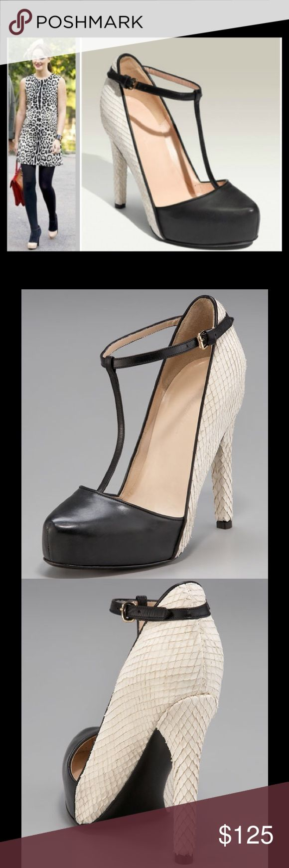 3.1 Phillip Lim Black Multi Calder T-Strap Pump Excellent like new condition. 3.1 Phillip Lim reinterprets the classic spectator pump with several notable twists: equipping it with a platform for added height, a T-strap to secure dipped construction, and juxtaposing textures in addition to colors. Leather T-strap, pointed-toe front with snake-embossed leather shank, back, and heel. Seam defines concealed platform. Adjustable buckle. Covered heel. No box. Size 37. 3.1 Phillip Lim Shoes…