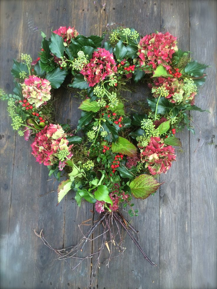 Green funeral flowers. Heart-shaped autumn funeral wreath.  Made on a mossed base of silver-birch twigs, dressed with ivy flowers, hydrangeas and sedums. 100% biodegradable.