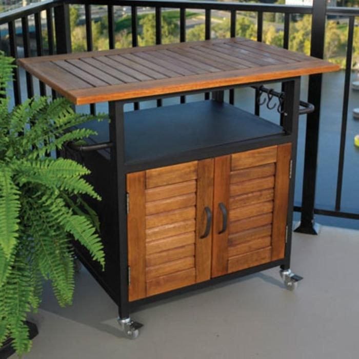 Versatile rolling BBQ stand has plenty of built-in storage.