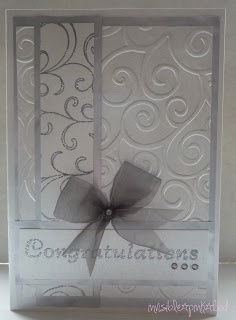 Wedding anniversary card. Embossing and heat embossing on silver cardstock.