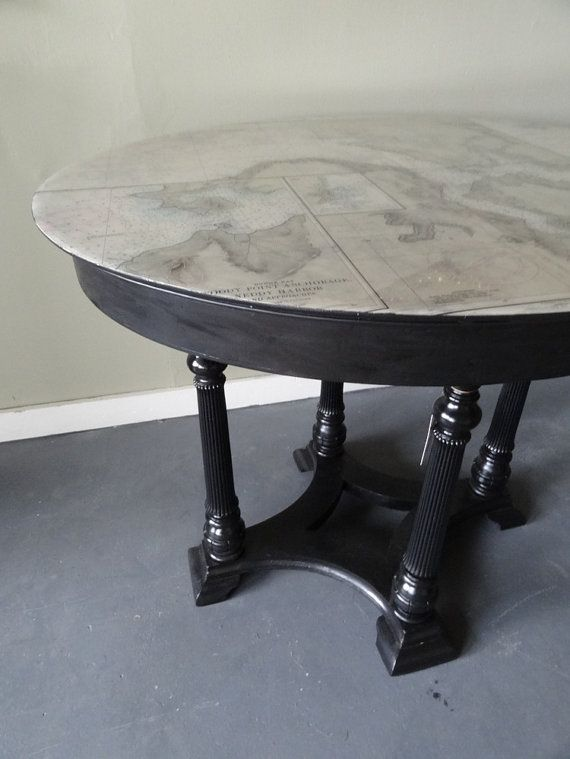 Black oval parlor table with nautical map top