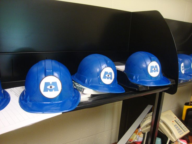 Monsters Inc Hats are easy to make. Buy a yellow ADULT plastic construction hat from amazon (less than a $1 a piece), spray paint them blue, cut out the logo and mod podge on!