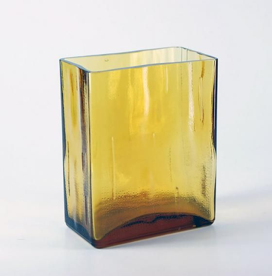 "Manufacturer: Riihimäki Glass  Designed: 1971  Height: 150 mm  1970s. Made also higher (serial number 1592) and wider (serial number 1593). The surface pattern is the same as the ""Pala"" vases and ""Lankkupulloissa""."